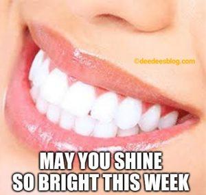 Woman shining teeth